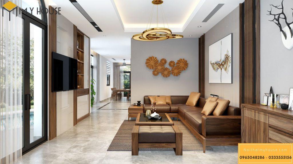 Nội thất phòng khách với tông màu đặc trưng của gỗ óc chó và màu vàng đồng của đồ trang trí cao cấp