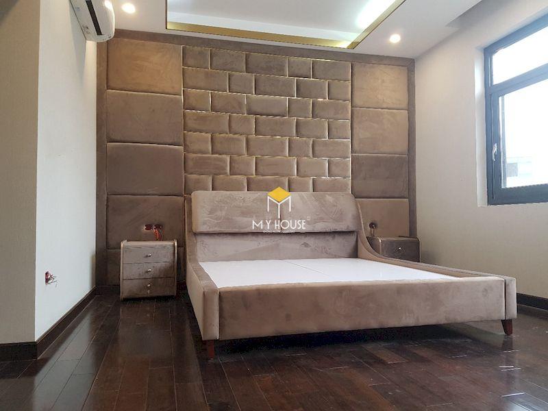 Thiết kế giường ngủ với màu sắc và chất liệu phù với tổng thể nội thất