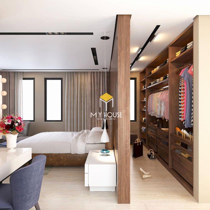 Thiết kế phòng thay đồ mini đặt sau giường ngủ, ngăn cách bằng vách ngăn gỗ