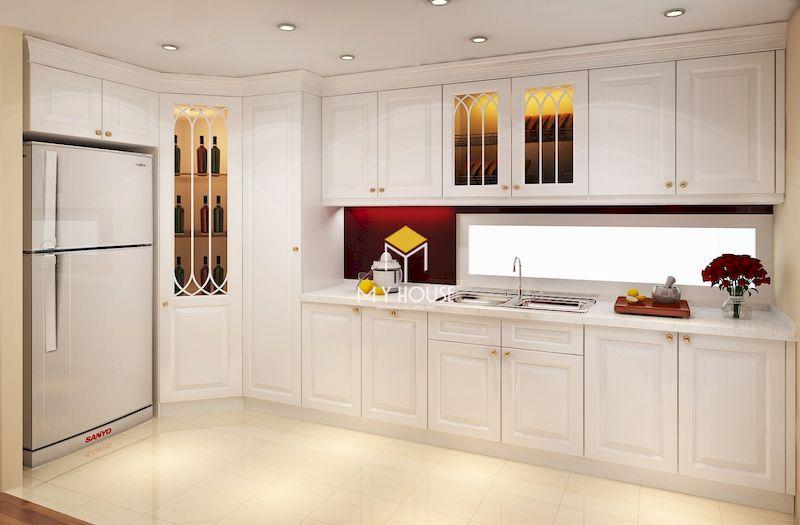 Tủ bếp tân cổ điển gỗ tự nhiên sơn màu trắng sang trọng phù hợp với tổng thể nội thất