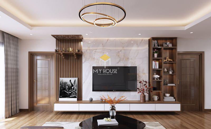 Mẫu vách tivi phòng khách hiện đại cho chung cư óc chó kết hợp kệ tivi, kệ trang trí