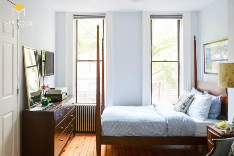 Kê giường ngủ đúng cách - Không kê giường dựa tường nhà vệ sinh
